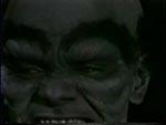 Et af de dæmoniske ansigter som jævnligt er klippet ind.