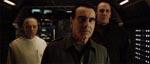 Den grotesk overspillende Dan Hedaya som General Perez i midten, flankeret af Dr. Gediman (Brad Dourif) og Dr. Wren (J. E. Freeman).