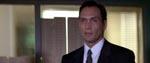 FBI-agent John Travis (Jimmy Smits)