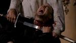 Domastir (Will Sanderson) får halsen skåret over.