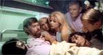 Krankheit i gruppe-komsammen i en patients seng