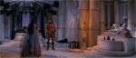 Conan får opgaven af Dronning Taramis. Til højre ses statuen af guddommen Dagoth.