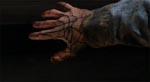 Ash ser sin hånd blive besat!