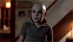 Tommy (Corey Feldman) ved filmens slutning.