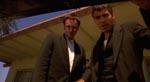 Richard og Seth Gecko (Quentin Tarantino og George Clooney) snakker til gidslet, som ligger i deres bagagerum.