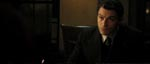 Politibetjenten Popil (Dominic West).