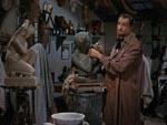 Kunstneren Henry Jarrod (Vincent Price) på arbejde