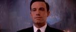 Slimet som en ål og med et selvglad smil - Ben Affleck som Jennings.