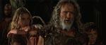 Kris Kristofferson som langhåret gamling og i baggrunden filmens blikfang Daena, spillet af Estella Warren.