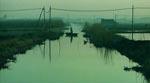 Fiskeren i den beskidt udseende kanal