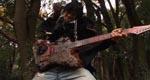 Den mystiske hævner – her spillende enormt hurtigt på sin guitar