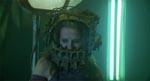 Amanda (Shawnee Smith) i flashback-scenen med det kæberaslende apparat spændt om hovedet.
