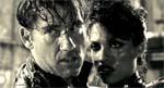 Dwight og Gail (Clive Owen og Rosario Dawson)