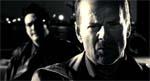Hartigan (Bruce Willis) - og i baggrunden hans korrupte makker Bob (Michael Madsen)