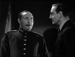 Inspektør Krogh (Lionel Atwill) og Baron Wolf von Frankenstein (Basil Rathbone).