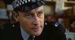 Sergeant Howie (Edward Woodward)
