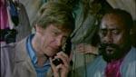 Dr. Peter Chandler (Ian McCulloch) & Molotto (Dakkar).