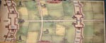 Bagsiden af udvidelsen, med bonusspillet 'Minas Tiriths Belejring'