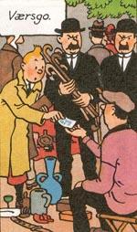 Tintin køber modelskibet på loppemarkedet.